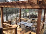 Deck overlooking the grill/fire pit area
