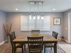 Dining room with large family table and 6 chairs - leads outside to the backyard patio!