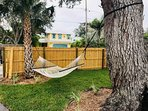 Outside, private and secure  patio oasis with beach bikes and hammock!