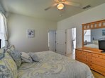 A king bed, flat-screen cable TV, and dresser highlight this welcoming space.