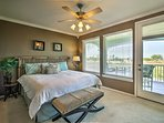 Head upstairs to the master bedroom with a king-sized bed.