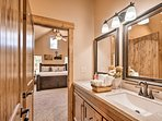 Walk through the bathroom to find the master bedroom.