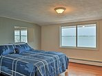 The first master bedroom has a queen bed and amazing waterfront views.