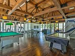 Shoot some pool or unwind on the large leather couch.
