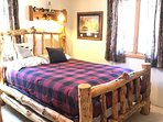Bedroom 1 with one queen log bed and one log bunk bed