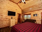 1st Upper Level King Size Master Suite with Private Bathroom and Queen Futon for additional guests.