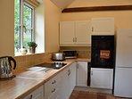 Kitchen with oven, hob, kettle, fridge, freezer, washing machine, dishwasher
