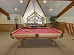 Enjoy a game of pool at the common area of Hidden River