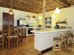 The kitchen at Villa Punta Coral is large enough to accommodate a second dining table and 4 chairs.