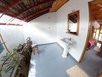 Fish eye view of the washbasin and shower area.