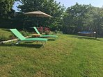 Sun loungers and Picnic Table, BBQ in the garden.