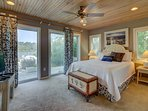 Water View- Master Bedroom w/ Queen Bed, TV, and Private Bathroom.