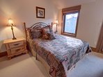 Queen size bed in the guest bedroom with access to the patio.