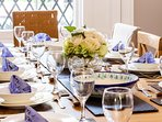 Dining table settings:  complete place settings and full range of cooking equipment provided