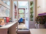 Landing outside conservatory/study: tourism leaflet & highchair storage
