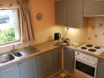 Well equipped bright kitchen. Oven, hob, microwave, fridge/freezer. Home baking awaits your arrival.