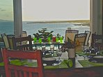 Indoor dining  room overlooking the outdoor dining are Sandy Hill beach and the Caribbeansea.
