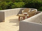 A cozy corner on the top balcony of the main villa to enjoy reading, visiting and the sunset
