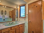 There is plenty of mirror space in the master bathroom.