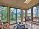 The sunroom features wall-to-wall windows.