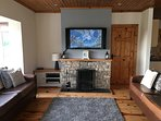 Open plan lounge with natural stone fire place and 46' TV with freeview
