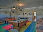 The colorful garage game room is ideal for some friendly competition.