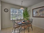 The 6-person dining table adjacent to the kitchen is perfect for a snack.