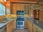 Stainless steel appliances & granite countertops elevate your cooking experience.