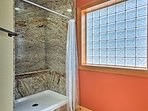 This bathroom also features a walk-in shower.