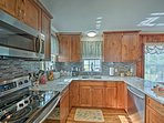 This bright kitchen comes fully equipped with all the necessary cooking appliances.