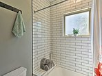 Classic subway tiles line the shower/tub combo.