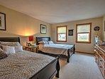 The third bedroom features 2 queen beds.