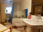 Roomy bathroom with 4 piece suite and a sit down shower.