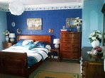 Large first floor bedroom with antique wardrobe, king size bed and views to Balmashanner Hill.