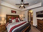 Master bedroom with king bed and walk in closet