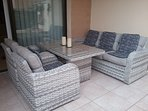 Patio just outside the living room and directly beside the pool