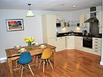Open plan dining /kitchen which is well stocked with all appliances required.