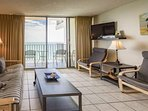 Relax and enjoy TV after busy vacation days in this well furnished living room.