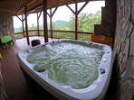 The hot tub offers the perfect perch to enjoy beautiful mountain views!