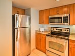 The fully equipped kitchen has stainless steel appliances.