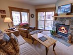 Unwind next to the stone fireplace & TV!