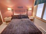 Queen bed in the master bedroom.