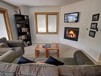 Relax with the fireplace, TV and views!