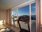 Gym on the last floor of the house with sea view