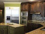 Maple wood stained cabinets and granite counter tops. Creates a luxury beach cooking environment.