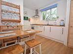 Bright and airy kitchen looking out to the rear garden