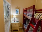 Our Crew's Quarters is a Kid's Paradise. There's a cool red bunk bed set and their own TV, too!  This is a real bunk...