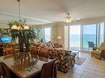 Elegant dining table seats 6 with additional seating for 4 at the bar.  Beautiful coastal dinnerware completes the...