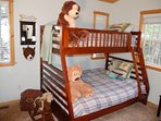 Kids room sleeps three with full bed on the bottom and twin bed on top