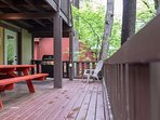 Huge deck with access right off the kitchen.  We provide a gas grill for you and plenty of seating.